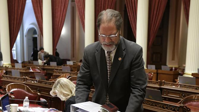 State Sen. John Moorlach, R-Costa Mesa, gathers his binders together as he prepares to leave the Senate after session at the Capitol in Sacramento, Calif., Friday, June 19, 2015. Both houses of the Legislature approved the $115.4 billion compromise spending plan and sent it to the governor.(AP Photo/Rich Pedroncelli)