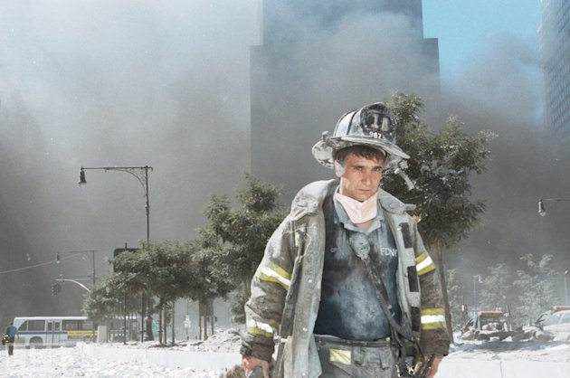 An unidentified New York City fireman walks away from Ground Zero after the collapse of the towers.