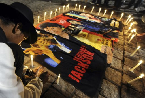 Brazilian fan of U.S. singer Michael Jackson lights candles as part of the celebrations of the third anniversary of his death in Sao Paulo