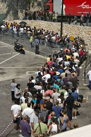 Israelis queue to collect gas mask kits at a distribution …