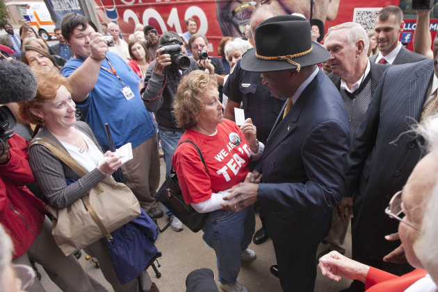 Republican Presidential candidate, Herman Cain campaigns in Talladega, Ala., Friday, Oct. 28, 2011. (AP Photo/Dave Martin)