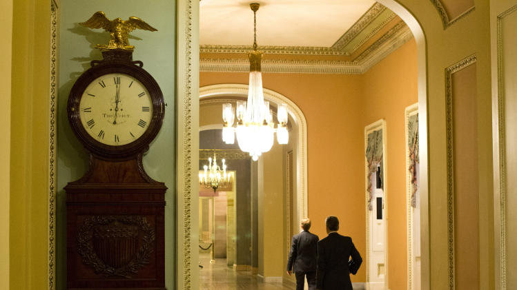 In this Oct. 1, 2013, photo, The Ohio Clock outside the Senate Chamber on Capitol Hill shows the time of 12:01 a.m., in Washington. Having failed to persuade their traditional Republican allies in Congress to avert a government shutdown, business leaders fear bigger problems ahead, and they're taking sides with a Democratic president whose health care and regulatory agenda they have vigorously opposed. (AP Photo/Evan Vucci)
