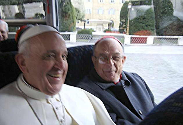 In this photo released by the National Conference of Brazilian Bishops, Pope Francis, left, is seen aboard a minibus with other Cardinals at the Vatican, the day after his election, Thursday, March 14, 2013. (AP Photo/CNBB, Antonio Luiz Catelan)