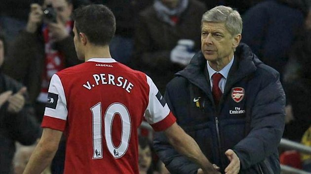 Arsenal's Robin Van Persie (L) shakes hands with manager Arsene Wenger (Reuters)