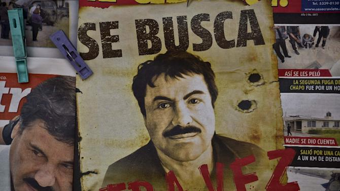 "A poster with the face of Mexican drug lord Joaquin ""El Chapo"" Guzman, reading ""Wanted, Again"", in Mexico City on July 13, 2015"