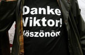 """A supporter of the Hungarian PM Orban, wearing a shirt with a slogan reading """"Thank you Viktor!"""", stands during a CSU party event in Kloster Banz near Bad Staffelstein"""