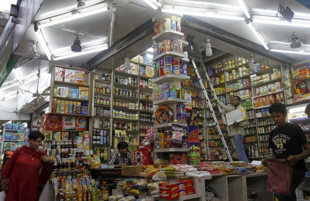 Customers shop in a family-owned store at a market in New Delhi