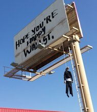 This image provided by KVVU-TV shows a billboard with a mannequin dangling from a hangman's noose near The Strip in Las Vegas. Authorities said calls began coming in early Wednesday Aug. 8, 2012, from drivers worried the dummy along Interstate 15 near was a real person. A Nevada Highway Patrol spokesman said the sign is a publicity stunt done in bad taste. A woman who answered the phone at Lamar Advertising Co. says the sign was not authorized and was being removed. (AP Photo/KVVU, Peter Dawson)