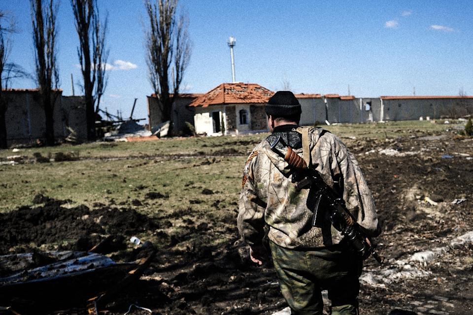 A pro-Russian rebel stands guard  in the village of Spartak near Donetsk airport on April 10, 2015