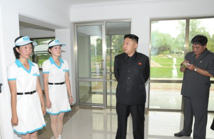 Kim Jong-Un visits a building at a mini-golf course at the Rungna People's Pleasure Ground in this undated picture released by KCNA