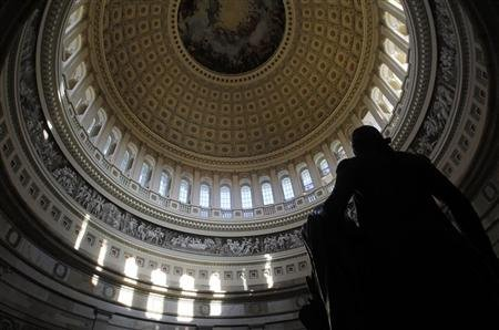 Reuters/Reuters - A statue of the United States first President, George Washington, is seen under the Capitol dome in Washington January 2, 2013. REUTERS/Gary Cameron