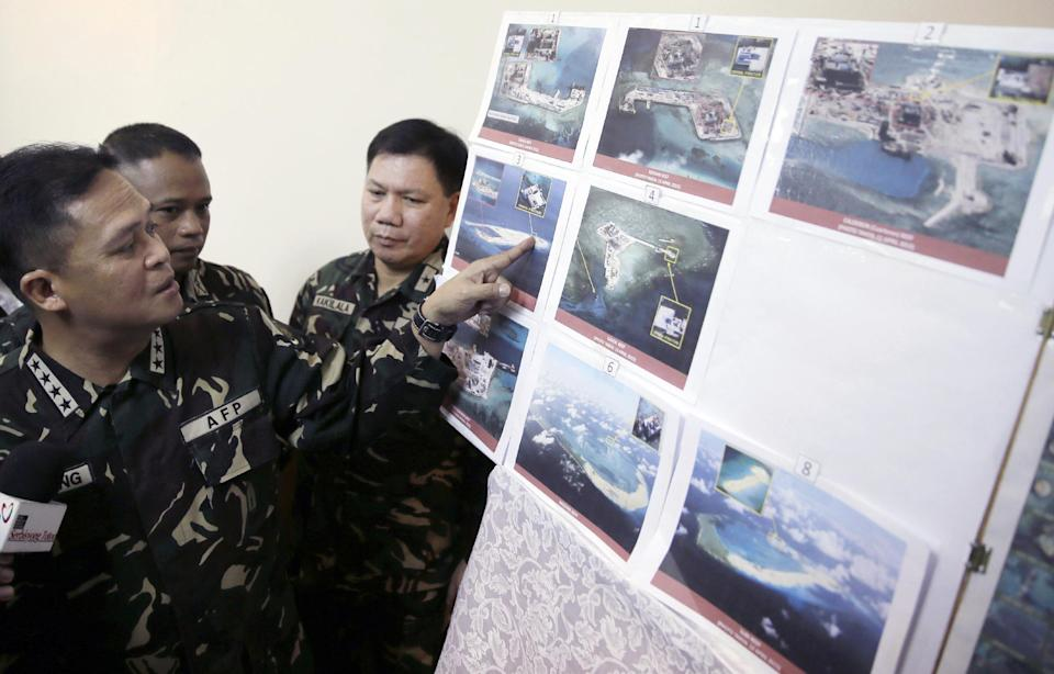 FILE - In this April 20, 2015  file photo, Armed Forces of the Philippines Chief of Staff Gen. Gregorio Pio Catapang, left, points to reveal recent...