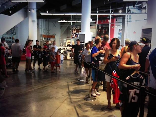 New England Patriots Fans line-up to exchange their Aaron Hernandez jerseys.