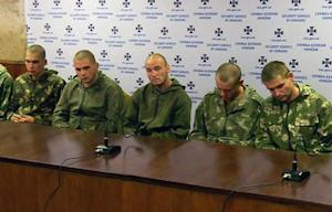 Captured Russian paratroopers are seen in this image …