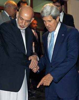 U.S. Secretary of State John Kerry, right, and Afghanistan's …