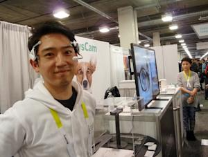 Alex Chang of Looxid Labs demonstrates a brainwave …