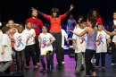 U.S. first lady Michelle Obama dances on stage with school children during an event to bring physical activity back to schools in Chicago