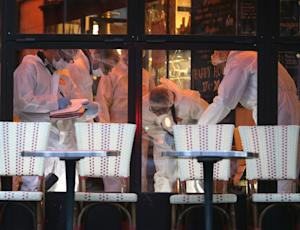 Forensic scientists inspect the Cafe Bonne Biere