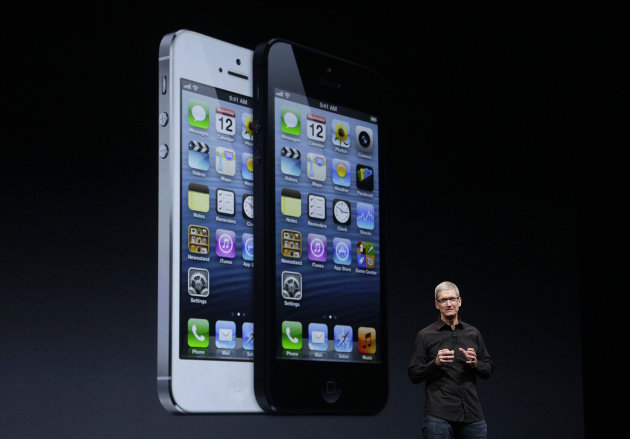 <p>               Apple CEO Tim Cook speaks in front of an image of the iPhone 5 during an Apple event in San Francisco, Wednesday, Sept. 12, 2012. (AP Photo/Jeff Chiu)