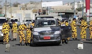 Shi'ite Houthi rebels in police uniform search …