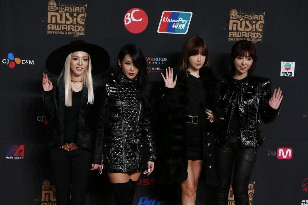 Members from 2NE1 pose on the red carpet during Asian Music Awards in Hong Kong