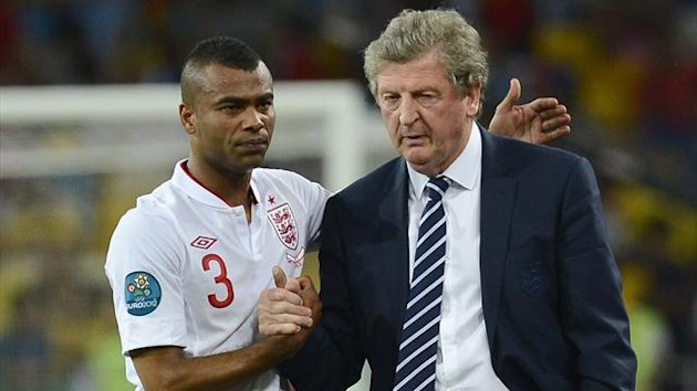 Ashley Cole and Roy Hodgson after England's Euro 2012 elimination by Italy