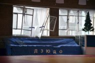 Broken windows and debris are seen inside a sports hall following sightings of a falling object in the sky in the Urals city of Chelyabinsk February 15, 2013. REUTERS/OOO Spetszakaz