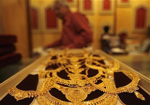 Gold jewellery is displayed at a jewellery shop in Kolkata