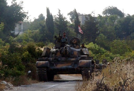 A handout picture released by the Syrian Arab News Agency (SANA) on August 8, 2013 shows Syrian army tanks parked on the side of a road during an alleged pursuit of opposition fighters in the Latakia province, western Syria. Fierce fighting raged in Latakia province on Syria's coastline on Sunday, as the army pushed an advance and killed a jihadist leader, a monitoring group said