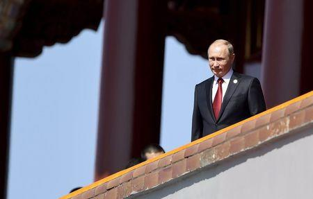 woRussia's President Putin is seen on the Tiananmen Gate, at the beginning of the military parade marking the 70th anniversary of the end of World...