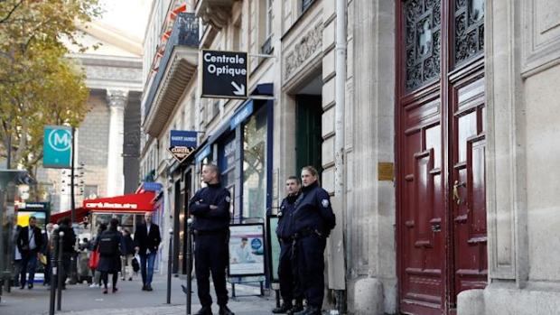Police stand guard at the entrance of the luxury residence where US reality television star Kim Kardashian was robbed at gunpoint by assailants disguised as police, in Paris, in October 2016