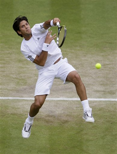 Fernando Verdasco of Spain smashes the ball to Andy Murray of Britain during their Men's singles quarterfinal match at the All England Lawn Tennis Championships in Wimbledon, London, Wednesday, July 3, 2013