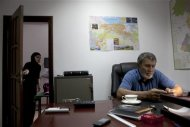 Village administrator Aliaskhab Magomedov (R) speaks during an interview at his office in the village of Gimry, July 9, 2012. REUTERS/Maria Turchenkova