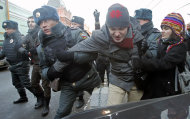 "FILE - In this Wednesday, Dec. 19, 2012 file photo police officers detain gay right activists during a protest near the State Duma, Russia's lower house of parliament, in Moscow, Russia. A controversial bill banning ""homosexual propaganda"" has been submitted to Russia's lower house of parliament for the first of three hearings Tuesday, Jan. 22. 2013. (AP Photo/Misha Japaridze, file)"