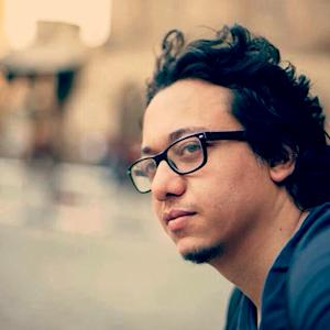 In this Aug. 23, 2015 photo, Islam Gaweesh takes a tour of Moaez Street in downtown Cairo, Egypt. Gaweesh, an Egyptian cartoonist, who has been critical of government policies, was arrested in the capital, Cairo, on Sunday, Jan. 31, 2016, and charged with running a webpage without a license, the country's Interior Ministry said in a statement. The arrest of the cartoonist appears to be part of an intensified clampdown on activists and journalists in Egypt, where many have been detained, questioned and even forcibly disappeared in recent months. (AP Photo/Mostafa Darwish)