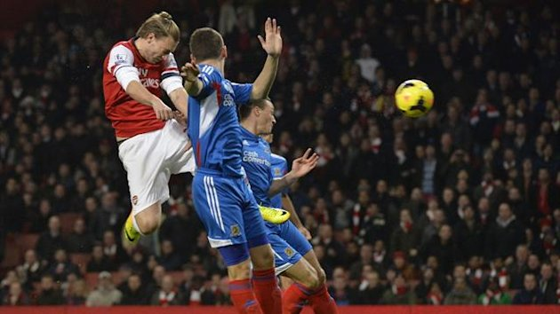Nicklas Bendtner heads Arsenal ahead against Hull (Reuters)