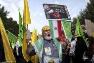 "An Iranian man chants slogans as he holds an anti-Israeli placard with a portrait and quotation of Lebanese Hezbollah leader Sheik Hassan Nasrallah during an annual pro-Palestinian rally marking Al-Quds (Jerusalem) Day in Tehran, Iran, Friday, Aug. 2, 2013. Ahead of his inauguration, Iran's new president, Hasan Rouhani, on Friday called Israel an ""old wound"" that should be removed, while thousands of Iranians marched in support of Muslim claims to the holy city of Jerusalem. (AP Photo/Ebrahim Noroozi)"