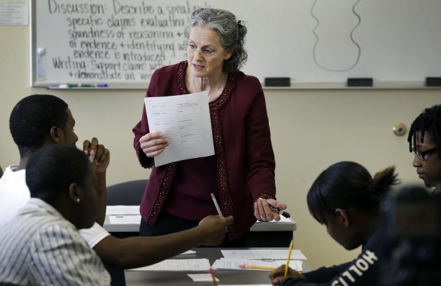 In this Thursday, April 11, 2013 photo, Deni Loving teaches a GED class in Kansas City, Mo. Several dozen states are looking for an alternative to the GED high school equivalency test because of concerns that a new version coming out next year is more costly and will no longer be offered in a pencil and paper format. (AP Photo/Orlin Wagner)