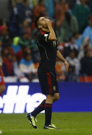 Mexico´s Oribe Peralta pauses after missing a chance …