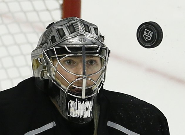 Kings goalie Quick keeps his eyes on the puck as he makes a save against the Sharks during Game 5 of their NHL Western Conference semifinals playoff in Los Angeles