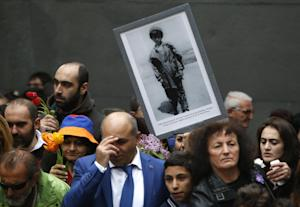 People gather at a memorial to Armenians killed by …