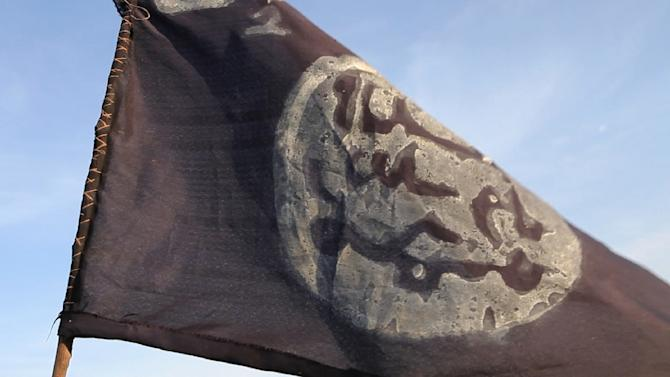 A Boko Haram flag flutters from an abandoned command post in Gamboru, Nigeria, on February 4, 2015