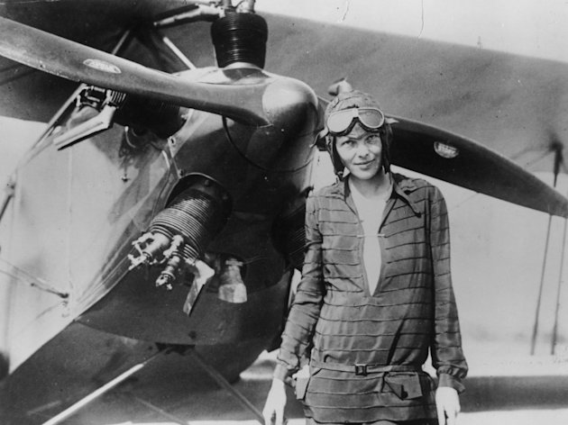 "Amelia Earhart stands June 14, 1928 in front of her bi-plane called ""Friendship"" in Newfoundland. (Photo by Getty Images)"
