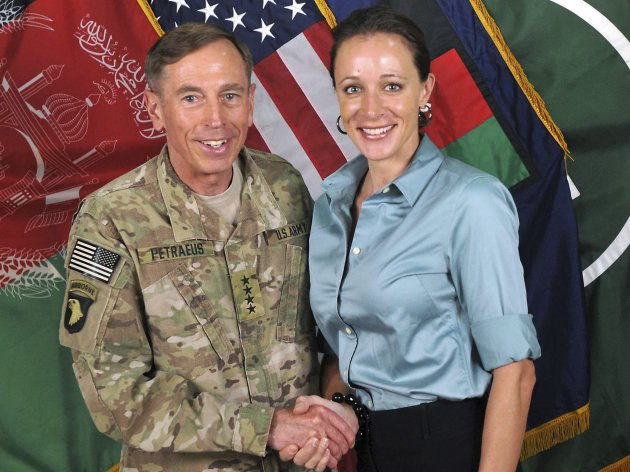 "Commander of the International Security Assistance Force/U.S. Forces in Afghanistan General David Petraeus shakes hands with author Paula Broadwell in this ISAF handout photo originally posted July 13, 2011. The FBI investigation that led to the discovery of CIA Director David Petraeus' affair with author Paula Broadwell was sparked by ""suspicious emails"" from her to another woman and Petraeus was not the target of the probe, U.S. law enforcement and security officials told Reuters. REUTERS/ISAF/Handout (AFGHANISTAN - Tags: POLITICS MILITARY MEDIA) FOR EDITORIAL USE ONLY. NOT FOR SALE FOR MARKETING OR ADVERTISING CAMPAIGNS"