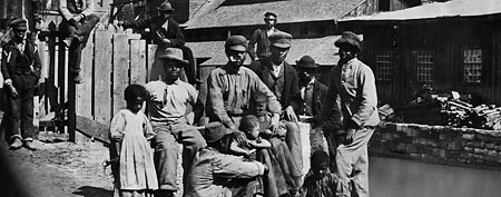 ca. 1860's, USA --- Freed slaves in Southern town shortly after the Civil War. © Bettmann/CORBIS