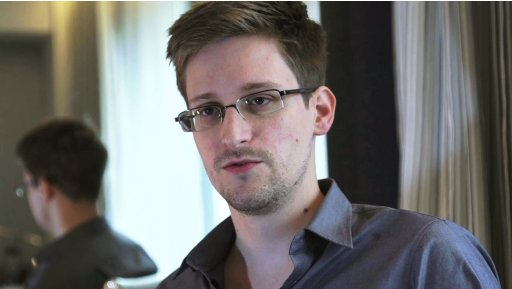 File photo of NSA whistleblower Edward Snowden being interviewed by The Guardian in his hotel room in Hong Kong