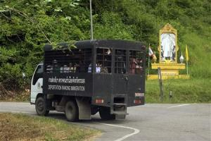 Thailand Immigration Police van carries a group of…