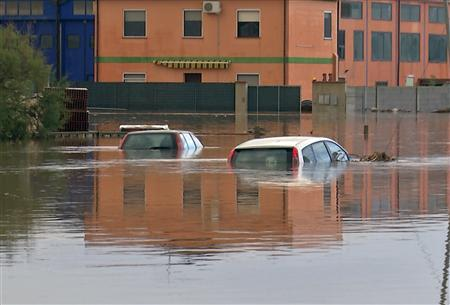 Submerged cars are seen on a flooded street in San Gavino Monreale on Sardina island November 18, 2013. REUTERS/Rosaspress
