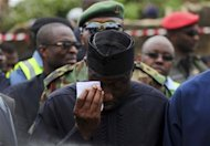 Nigeria's President Goodluck Jonathan wipes a tear after he arrived to inspect the site of a plane crash at Iju-Ishaga neighbourhood in Lagos June 4, 2012. REUTERS/Akintunde Akinleye