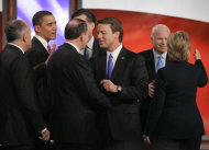 FILE - In this Jan. 5, 2008, file photo Democratic presidential hopeful, Sen. Barack Obama, D-Ill., second from left, talks with Republican presidential hopeful, former Massachussetts Gov. Mitt Romney, hidden fourth from left, on stage with other Democratic and Republican presidential hopefuls during a break in the debate at St. Anselm College in Manchester, N.H. When they stand side by side on the presidential debate stage Wednesday night, Oct. 3, 2012, it will be one of the few times Obama and Romney have ever even met in person. Others from left are former New York City Mayor Giuliani, former Arkansas Gov. Mike Huckabee, former Sen. John Edwards, D-N.C., Sen. John McCain, R-Ariz., and Sen. Hillary Clinton, D-N.Y. (AP Photo/Steven Senne, File)
